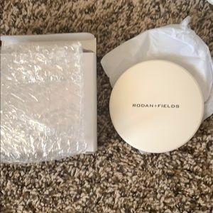 New in box Rodan + Fields mirror